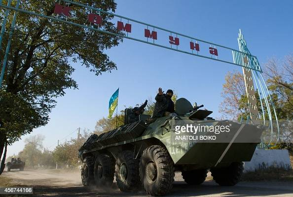 A Ukrainian armored personnel carrier patrols along a road leading to the town of Debaltseve in the Donetsk region on October 6 2014 The first...