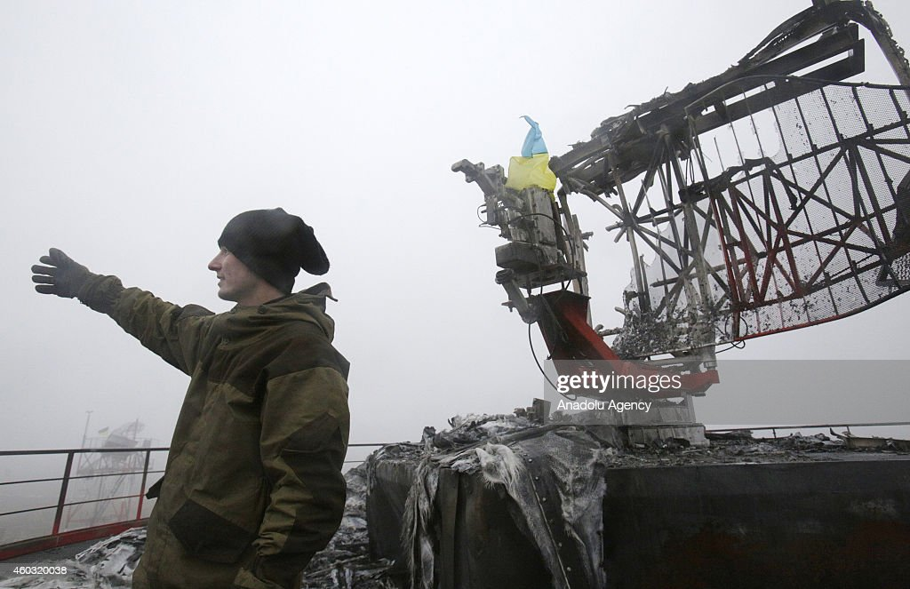 Ukrainian army member is seen during a patrol in the Tonenkoe town near Donetsk International Airport which was attacked by proRussian separatists...