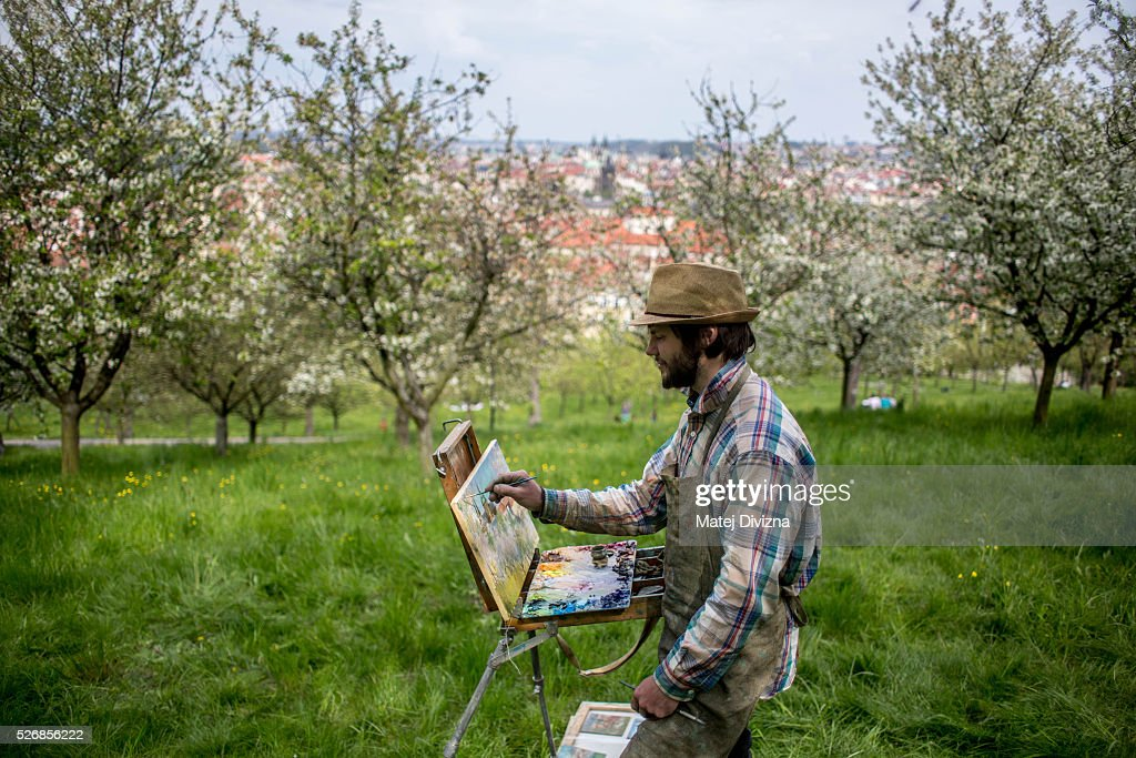 Ukrainian artist and painter Andriy Naboka paints picture at the Petrin Hill on May 1, 2016 in Prague, Czech Republic. Prague is attractive destination for artist from all over the world.