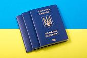 Ukrainian biometric passports against the background of the Ukrainian flag