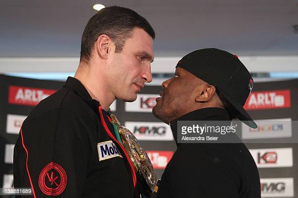 Ukrainian boxer Vitali Klitschko and British boxer Dereck Chisora pose for photographers during a press conference at Westin Grand hotel on February...