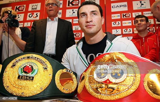 Ukrainian boxer Vladimir Klitschko sits behind the IBF and the IBO belts during a press conference 05 March 2007 in Heidelberg southern Germany prior...