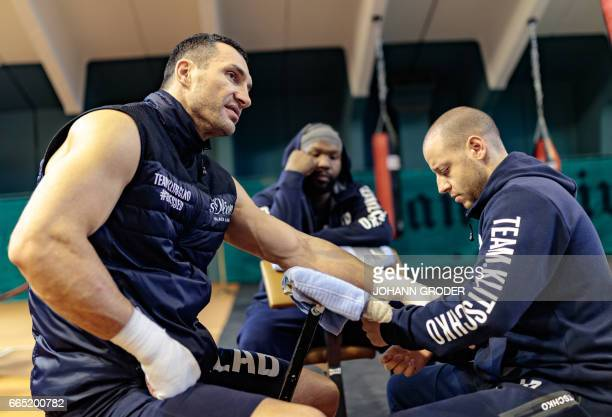 Ukrainian boxer Wladimir Klitschko his Coach Johnathon Banks and Physio Aldo Vetere are seen during a media training session on April 6 2017 at the...