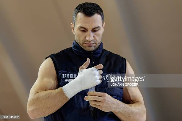 TOPSHOT Ukrainian boxer Wladimir Klitschko tapes his hands during training on April 6 2017 at the Biohotel Stanglwirt Going Austria as he prepares...