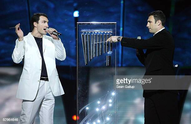 Ukrainian boxers Vitali Klitschko and Vladimir Klitschko strike the chimes to begin the 10minute telethon voting at the Eurovision Song Contest Grand...