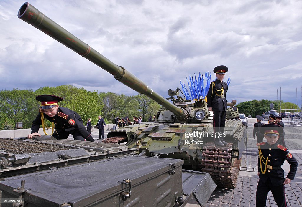 Ukrainian cadets play on a tank after a parade in honor of 71th anniversary of the victory over Nazi Germany in World War II at the Ukrainian State Museum of the Great Patriotic War in Kiev, Ukraine,06 May,2016.