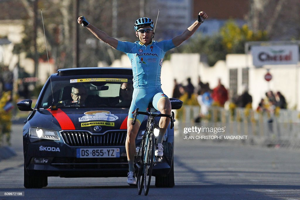 Ukrainian cyclist Andriy Grivko of Astana team celebrates his victory as he crosses the finish line of th third stage of the La Méditerranéenne cycling race, in the city of Pegomas, on February 13, 2016. / AFP / JEAN CHRISTOPHE MAGNENET