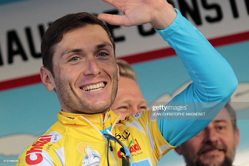 Ukrainian cyclist Andriy Grivko of the Astana team, waves as he poses on the podium after winning the first edition of The Mediterranean cyclist (La Méditerranéenne cycliste) in the fourth and last stage (95.7 km), on February 14, 2016, in the Italian city of Bordighera. / AFP / JEAN CHRISTOPHE MAGNENET