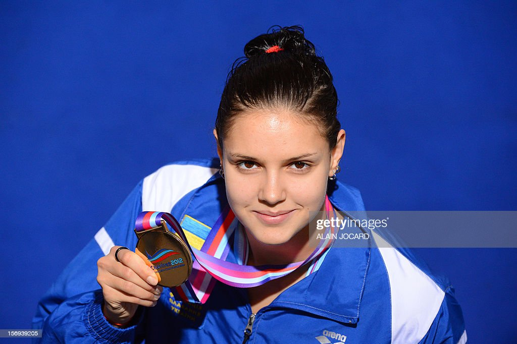 Ukrainian Daryna Zevina poses with the gold medal after winning the women's short course 200 m backstroke final at the European Swimming Championships on November 25, 2012, in Chartres.