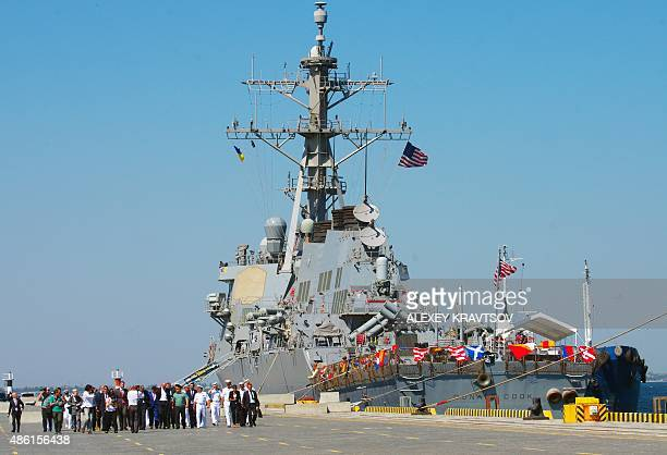 A Ukrainian delegation headed by the Prime Minister Arseniy Yatsenyuk and a US military delegation walk past the US Navy missile destroyer Donald...