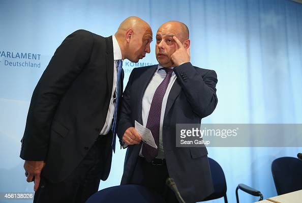Ukrainian Energy Minister Yuriy Prodan talks with Deputy Minister Igor Didenko after Prodan spoke at a press conference following talks with Russian...