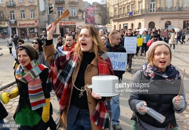 Ukrainian feminist supporters take part in a march marking of the 40th International Women's Day in the center of western Ukrainian city of Lviv on...