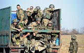 Ukrainian fighters from the Azov Battalion ride on a truck at a checkpoint on the outskirts of Mariupol on September 2 2014 Mariupol a large city of...