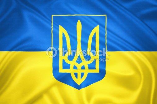 Ukrainian Flag And The Coat Of Arms Stock Photo Thinkstock