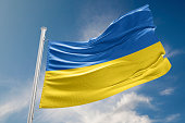 Ukrainian flag is waving at a beautiful and peaceful sky in day time while sun is shining. 3D Rendering