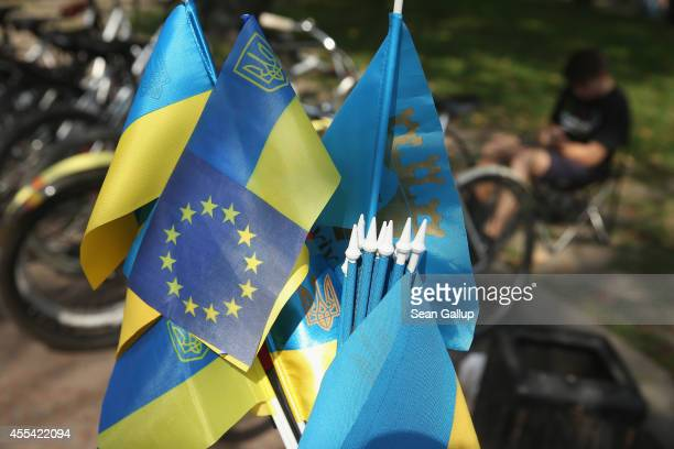 Ukrainian flag mixed with the flag of the European Union stands among flags for sale at a vendor's stall on September 14 2014 in Lviv Ukraine The...