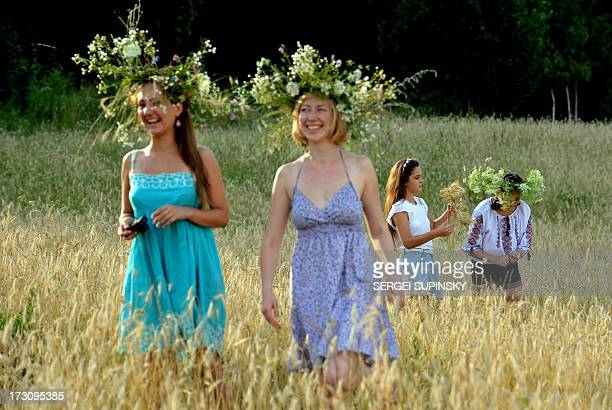 Ukrainian girls plait wreaths while celebrating Ivan Kupala Night a traditional Slavic holiday not far from Kiev on July 6 2013 During the...