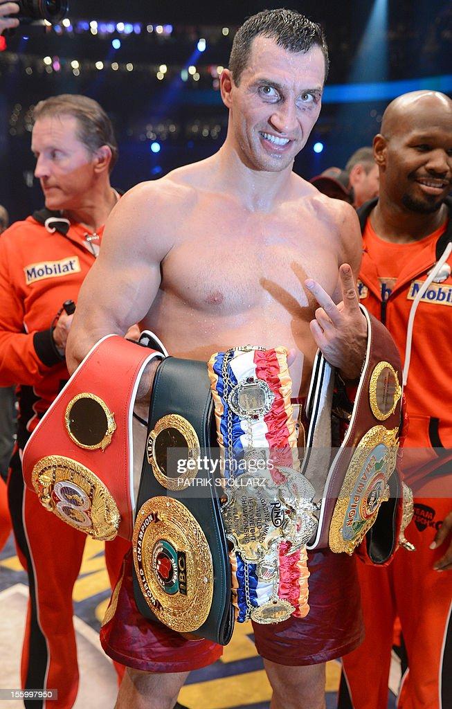 Ukrainian heavyweight boxing world champion Wladimir Klitschko celebrates after winning the fight against Polish challenger Mariusz Wach in the IBF...