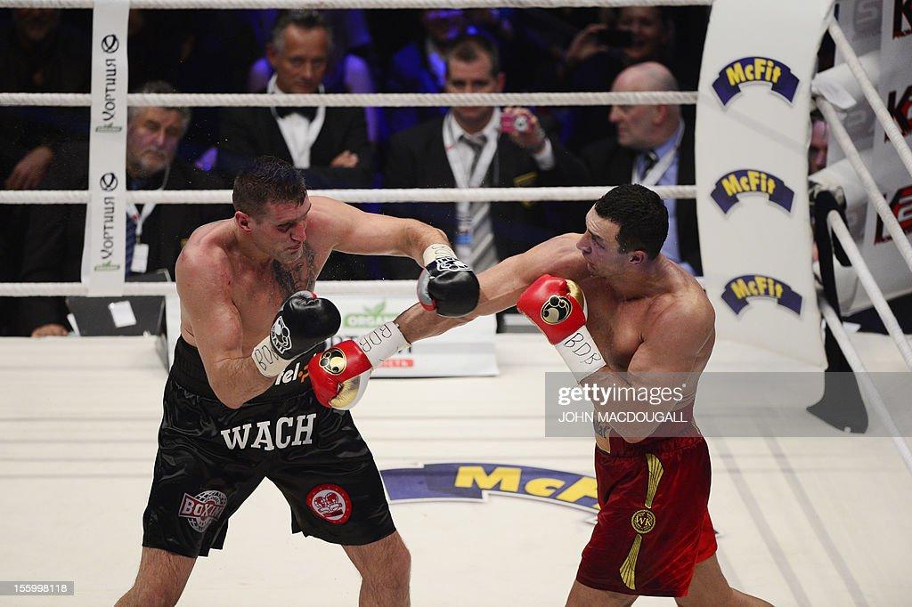 Ukrainian heavyweight boxing world champion Wladimir Klitschko fights with Polish challenger Mariusz Wach in the IBF IBO WBO and WBA title bout at...