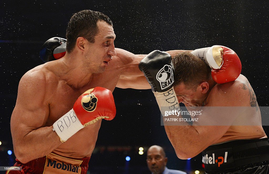 Ukrainian heavyweight boxing world champion Wladimir Klitschko (L) fights with Polish challenger Mariusz Wach in the IBF, IBO, WBO and WBA title bout at the O2 arena on November 10, 2012 in the nothern German city of Hamburg. AFP PHOTO / PATRIK STOLLARZ