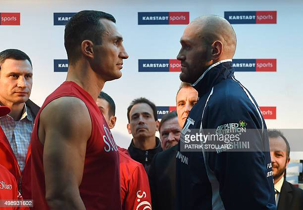 Ukrainian Heavyweight World Champion Wladimir Klitschko and his challenger Britain's Tyson Fury pose for a faceoff during an official weighin in...