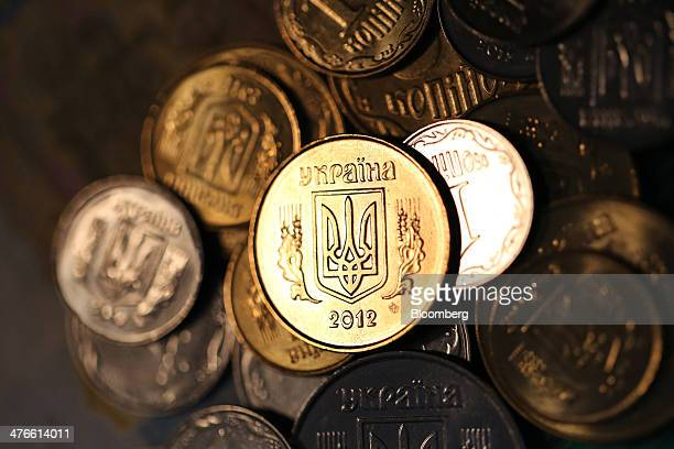 Ukrainian hryvnia kopec coins are arranged for a photograph in Moscow Russia on Tuesday March 4 2014 Goldman Sachs Group Inc predicts Russia will...