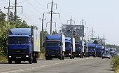 A Ukrainian humanitarian convoy rides near the eastern Ukrainian city of Severodonetsk Lugansk region on August 15 2014 A spokesman for the Ukrainian...