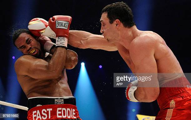 Ukrainian IBF and WBO heavyweight champion Vladimir Klitschko lands a right on US challenger Eddie Chambers during their heavyweight world...