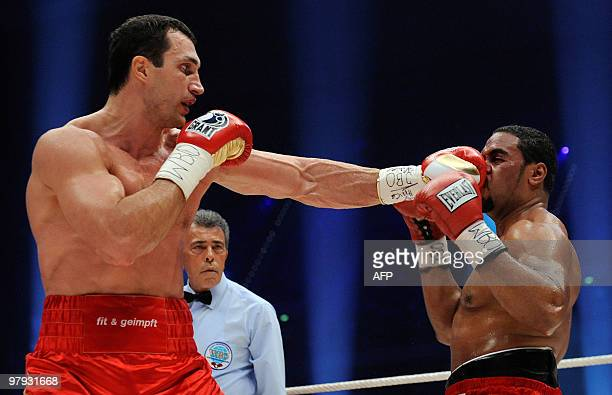 Ukrainian IBF and WBO heavyweight champion Vladimir Klitschko lands a left on US challenger Eddie Chambers during their heavyweight world...