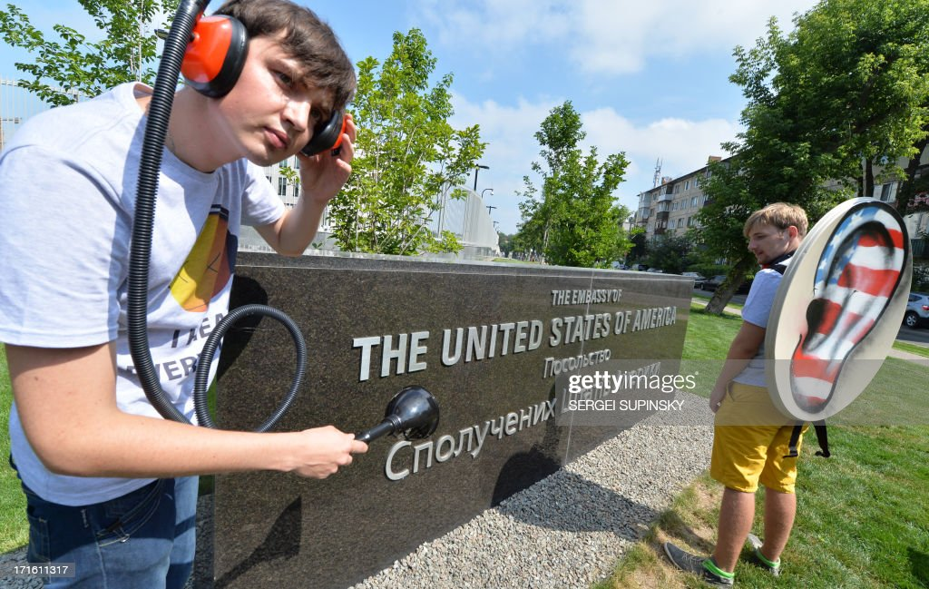 Ukrainian Internet Party activists hold a 'tap the phone and internet lines' protest on June 27 2013 outside the US Embassy in Kiev to attract public...
