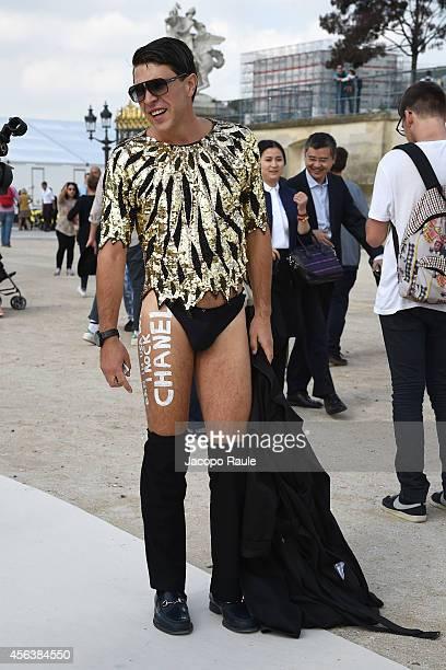 Ukrainian journalist/prankster Vitalii Sediuk looks on after pranking Singer Ciara as she arrived at Valentino Fashion Show during Paris Fashion Week...