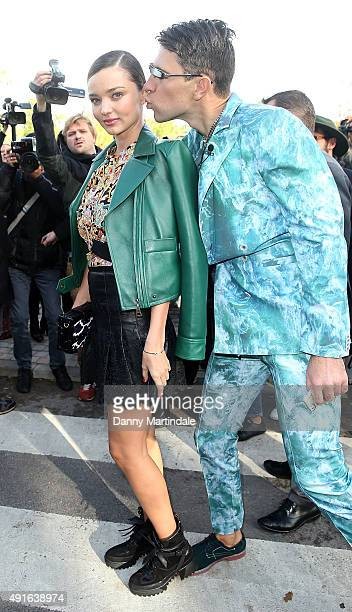 Ukrainian journalist/prankster Vitalii Sediuk targets model Miranda Kerr as she arrives to attend the Louis Vuitton show as part of the Paris Fashion...