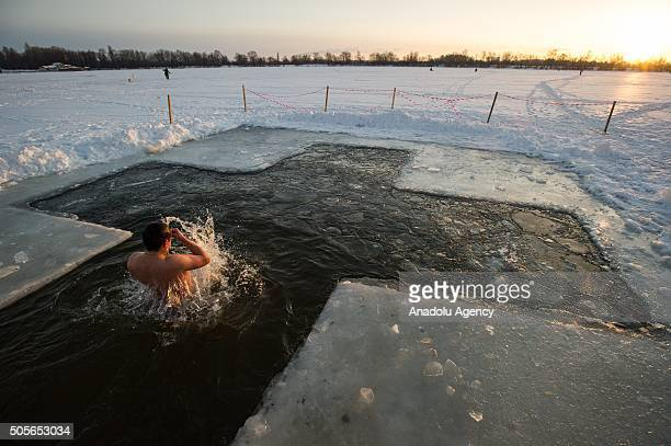 Ukrainian man bathes in Dnipro river during Epiphany celebrations in one of the suburban districts of Kiev Ukraine 19 January 2015