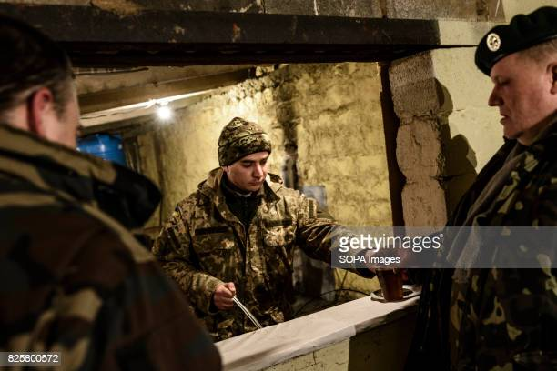 Ukrainian marine is pictured while serving tea to Algirdas Sim a reservist major in the Lithuanian armed forces He has been active in rallying aid...