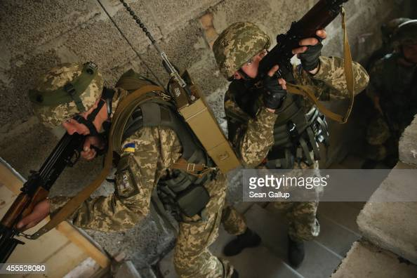 Ukrainian marines practice urban warfare techniques following instruction from US soldiers on the second day of the 'Rapid Trident' bilateral...