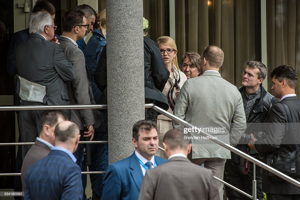 Ukrainian Member of Parliament Yulia Timoshenko (C) is surrounded by officials and staff as she waits to greet Ukrainian military pilot Nadiya Savchenko upon her arrival at Kyiv Boryspil Airport on May 25, 2016 in Boryspil, Ukraine. Savchenko was captured while fighting Russia-backed rebels in eastern Ukraine and put on trial in Russia on charges that she was complicit in the deaths of two Russian journalists. She was elected to the Ukrainian parliament under Tymoshenko's Fatherland party while being held in Russia, and in March she was convicted of murder and sentenced to 22 years in prison, but was reportedly swapped for two Russian fighters captured by Ukrainian forces.