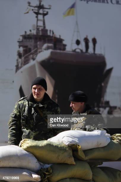 Ukrainian military personel stand inside a Ukrainian military base on March 17 2014 in Simferopol Ukraine Voters on the autonomous Ukrainian...