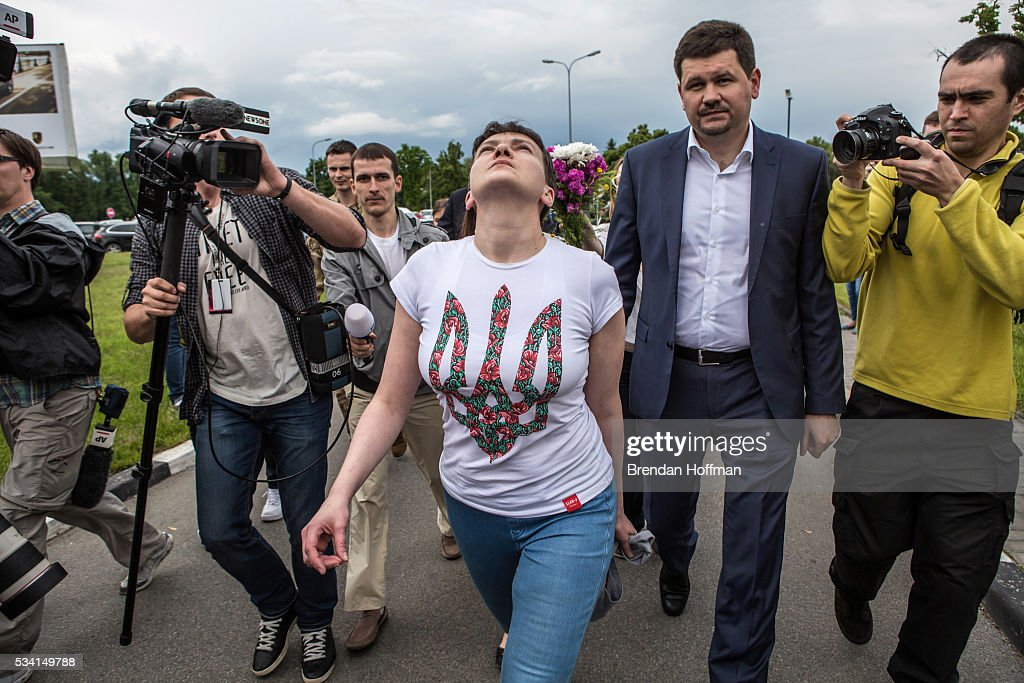 Ukrainian military pilot <a gi-track='captionPersonalityLinkClicked' href=/galleries/search?phrase=Nadiya+Savchenko&family=editorial&specificpeople=13678531 ng-click='$event.stopPropagation()'>Nadiya Savchenko</a> is surrounded by media upon her arrival at Kyiv Boryspil Airport on May 25, 2016 in Boryspil, Ukraine. Savchenko was captured while fighting Russia-backed rebels in eastern Ukraine and put on trial in Russia on charges that she was complicit in the deaths of two Russian journalists. In March she was convicted and sentenced to 22 years in prison, but was reportedly swapped for two Russian fighters captured by Ukrainian forces.