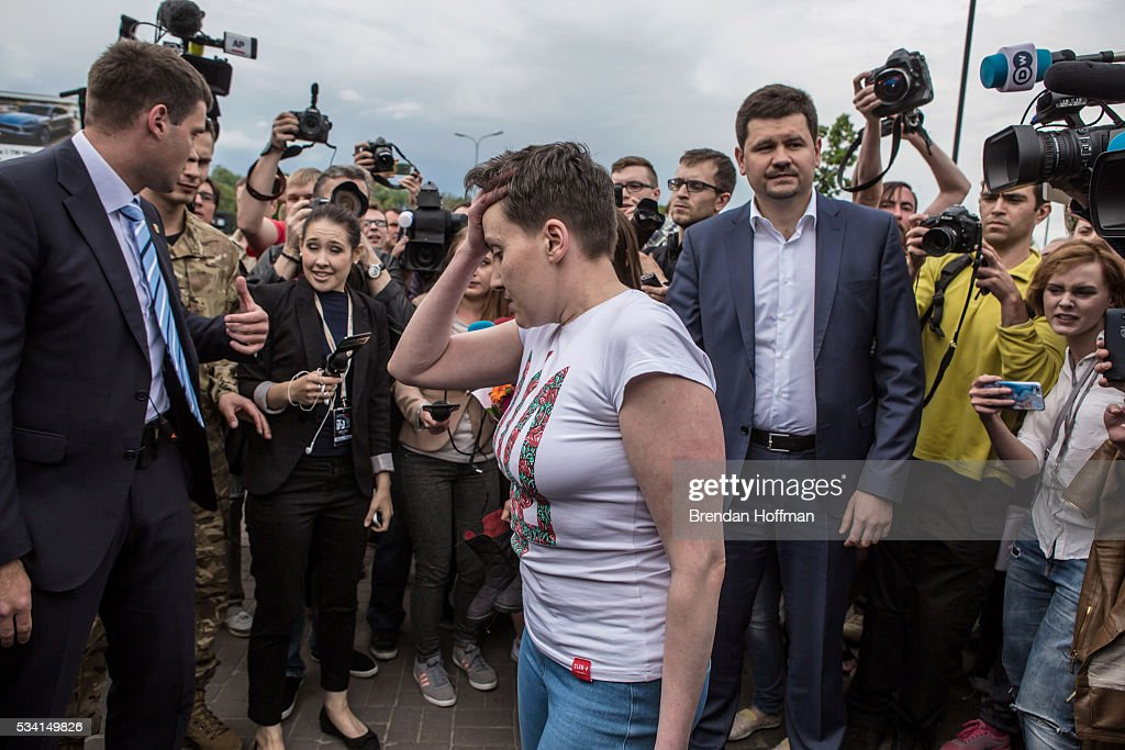 Ukrainian military pilot Nadiya Savchenko is surrounded by media upon her arrival at Kyiv Boryspil Airport on May 25, 2016 in Boryspil, Ukraine. Savchenko was captured while fighting Russia-backed rebels in eastern Ukraine and put on trial in Russia on charges that she was complicit in the deaths of two Russian journalists. In March she was convicted and sentenced to 22 years in prison, but was reportedly swapped for two Russian fighters captured by Ukrainian forces.