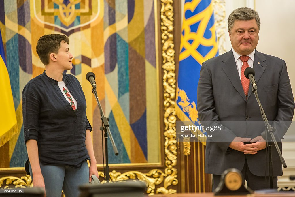 Ukrainian military pilot <a gi-track='captionPersonalityLinkClicked' href=/galleries/search?phrase=Nadiya+Savchenko&family=editorial&specificpeople=13678531 ng-click='$event.stopPropagation()'>Nadiya Savchenko</a> (L) joins Ukrainian president <a gi-track='captionPersonalityLinkClicked' href=/galleries/search?phrase=Petro+Poroshenko&family=editorial&specificpeople=549382 ng-click='$event.stopPropagation()'>Petro Poroshenko</a> to address the media at the Presidential Administration building following Savchenko's return to Ukraine on May 25, 2016 in Kiev, Ukraine. Savchenko was captured while fighting Russia-backed rebels in eastern Ukraine and put on trial in Russia on charges that she was complicit in the deaths of two Russian journalists. She was elected to the Ukrainian parliament under Tymoshenko's Fatherland party while being held in Russia, and in March she was convicted of murder and sentenced to 22 years in prison, but was reportedly swapped for two Russian fighters captured by Ukrainian forces.
