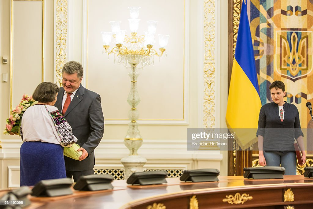 Ukrainian military pilot Nadiya Savchenko (R) watches as Ukrainian president Petro Poroshenko hugs her mother, Maria Savchenko (L), during an appearance to address the media at the Presidential Administration building following Savchenko's return to Ukraine on May 25, 2016 in Kiev, Ukraine. Savchenko was captured while fighting Russia-backed rebels in eastern Ukraine and put on trial in Russia on charges that she was complicit in the deaths of two Russian journalists. She was elected to the Ukrainian parliament under Tymoshenko's Fatherland party while being held in Russia, and in March she was convicted of murder and sentenced to 22 years in prison, but was reportedly swapped for two Russian fighters captured by Ukrainian forces.