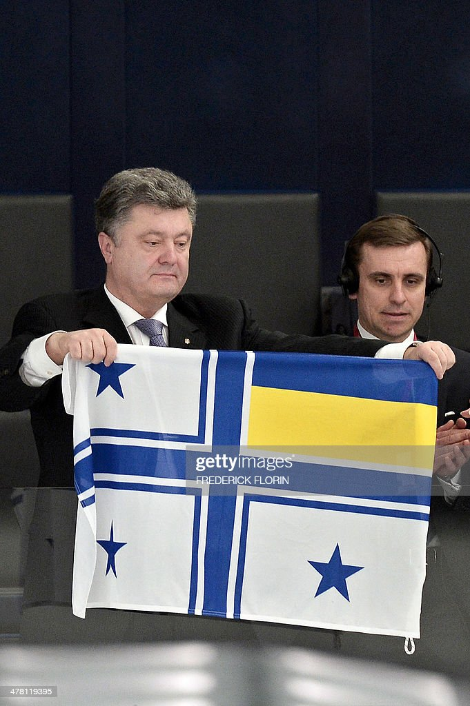 Ukrainian MP Petro Poroshenko holds a Ukrainian Navy Commander's flag during a debate as part of a plenary session at the European Parliament, on March 12, 2014 in Strasbourg, eastern France. Ukraine's acting president has said the country will not use its army to stop Crimea from seceding, the latest sign that a Russian annexation of the strategic peninsula may be imminent.