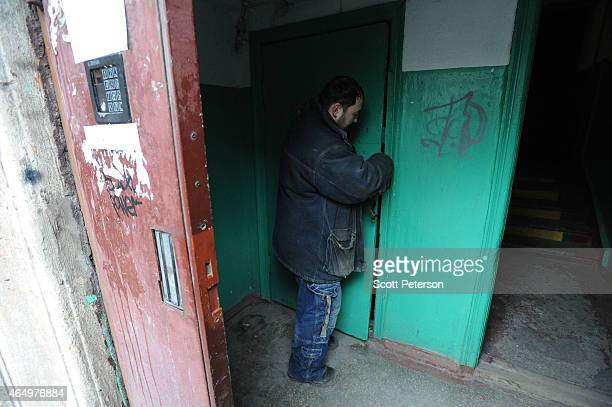 Ukrainian municipal worker Anton Kiriyakov opens the door to a stairwell leading to a Sovietera basement bunker designed for citizens during a...