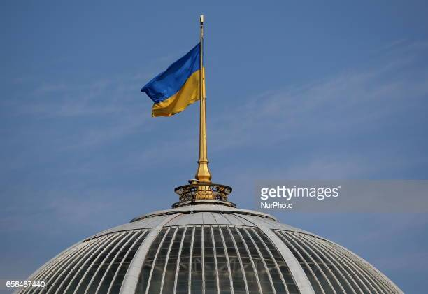 A Ukrainian national flag flies over the building of the Verkhovna Rada in central Kiev Ukraine Wednesday March 22 2017 The Verkhovna Rada urged the...
