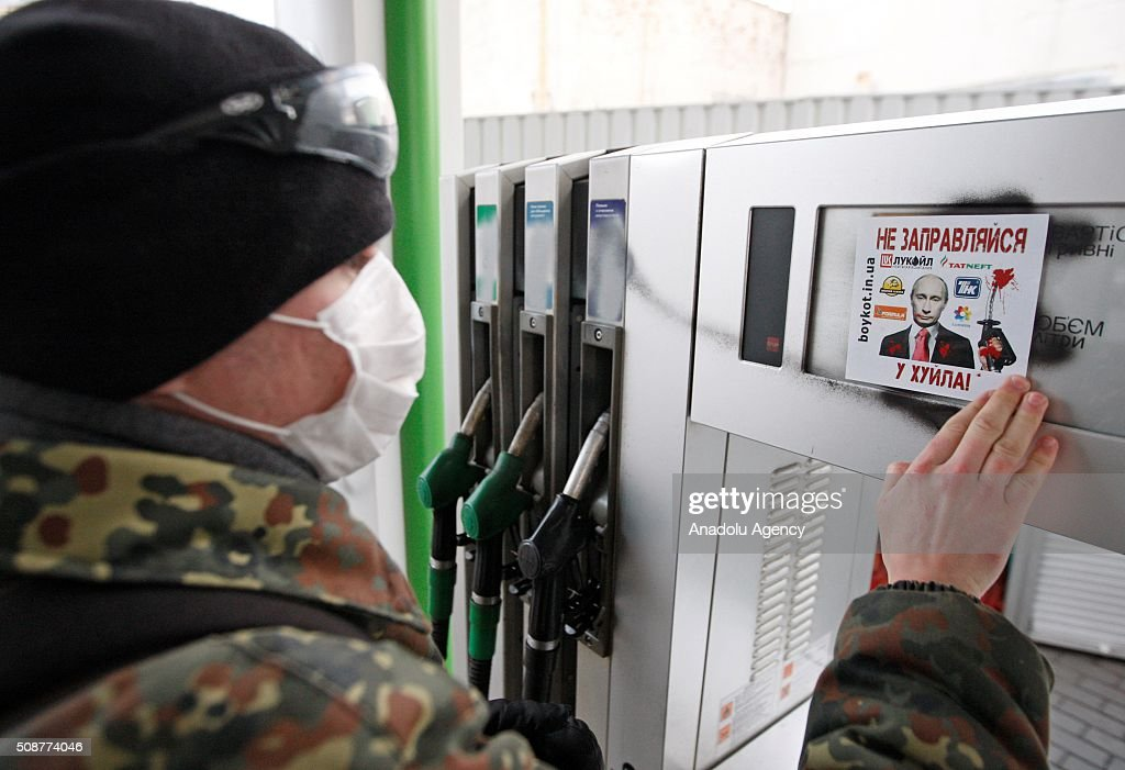 Ukrainian Nationalist organization Right sector member glues a leaflet on a gas pump during a protest against 'Russian business in Ukraine' in Kiev, Ukraine on February 06, 2016.