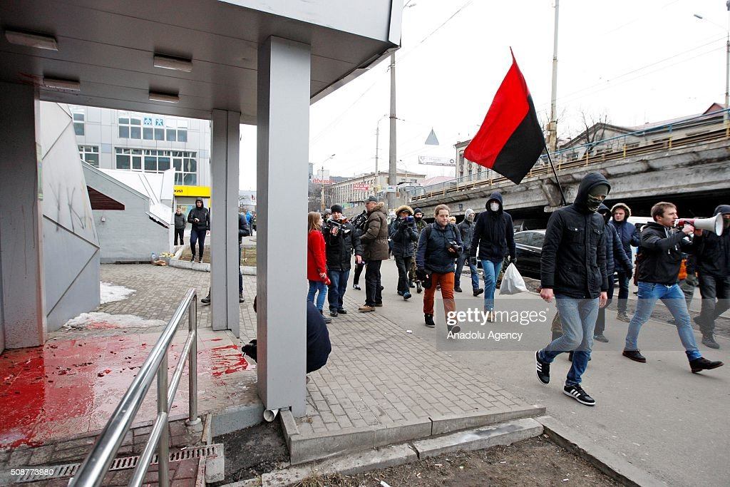 Ukrainian Nationalist organization Right sector members march in front of Russia's Sberbank during a protest against 'Russian business in Ukraine' in Kiev, Ukraine on February 06, 2016.
