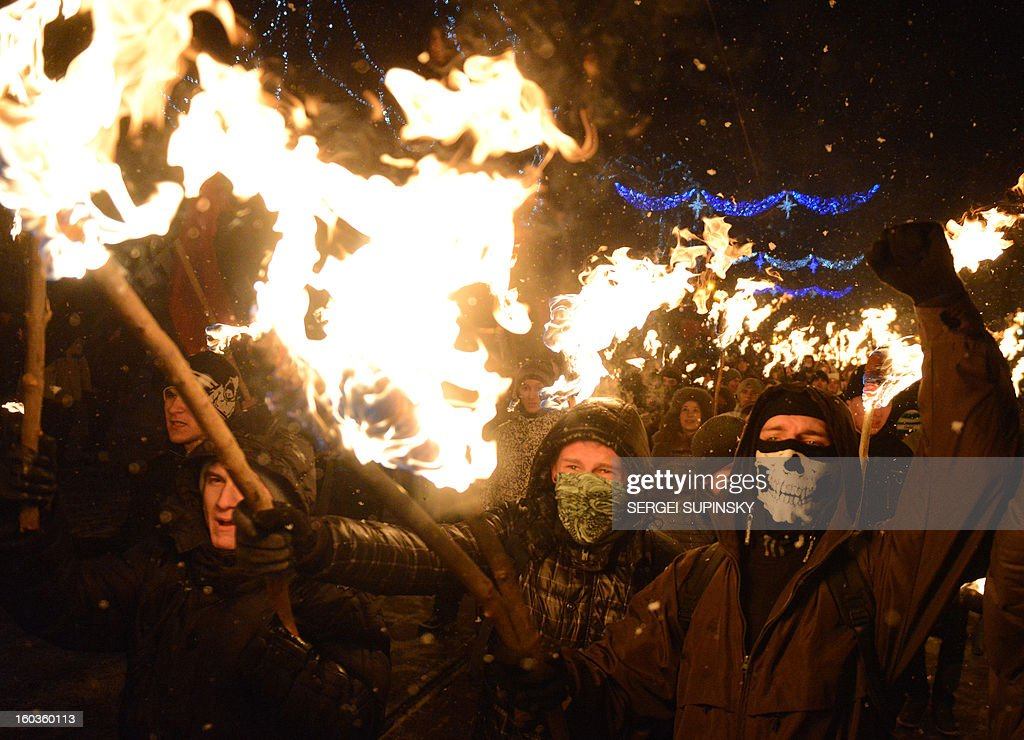 Ukrainian nationalists, carrying torches, march in the western Ukrainian city of Lviv late on January 29, 2013 marking the 95th anniversary of a battle near the small city of Kruty. 300 students, cadets and schoolboys were killed, during a combat against the regular Red Army on January 29, 1918, to protect the new-born Ukraine's People Republic against Bolshevik aggression.