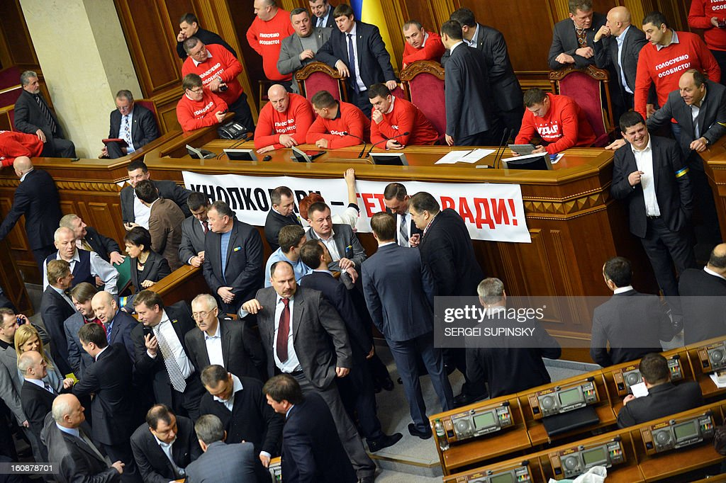 Ukrainian opposition deputies block on February 7, 2013 the parliament for a third day to prevent the session from opening in Kiev. The dispute in Ukraine's one-chamber parliament, known as the Verkhovna Rada, centers on opposition demands for each deputy to vote individually. Voting in the Ukrainian legislature is done electronically and lawmakers can delegate the right to vote to their colleagues. The opposition and critical media have repeatedly accused pro-government deputies of frequently missing parliamentary sessions and asking colleagues to vote on their behalf.