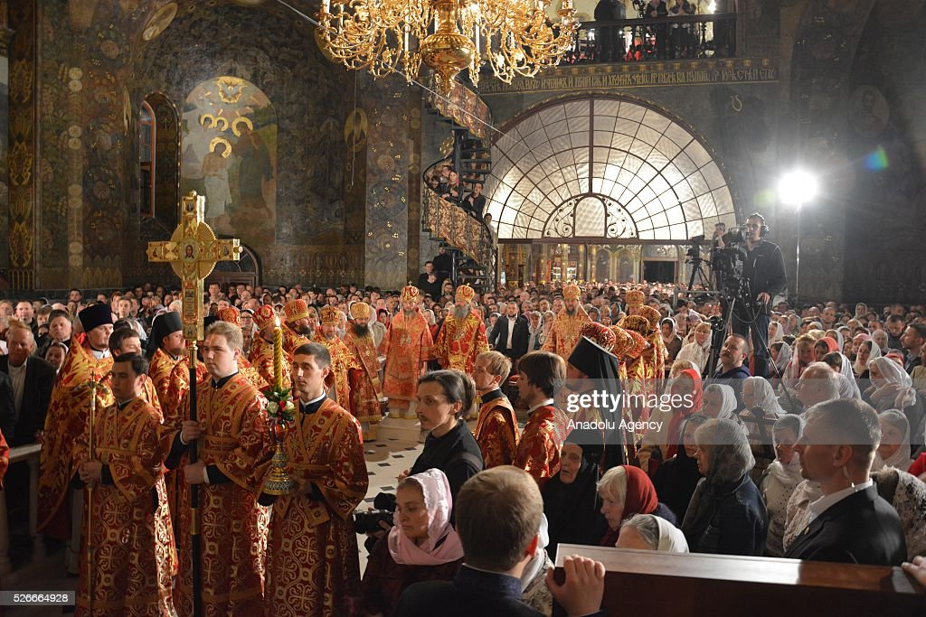 Ukrainian Orthodox Christians attend an Easter mass at a church in Kiev, Ukraine on May 1, 2016.