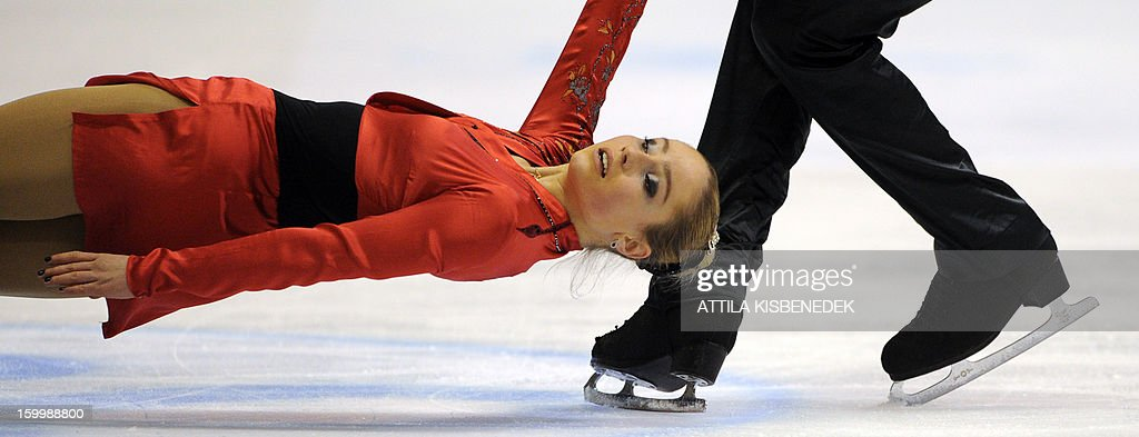 Ukrainian pair Julia Lavrentieva and Yuri Rudyk perform on ice of the 'Dom Sportova' sports hall in Zagreb on January 24, 2013 during the pairs free skating on day two of the ISU European Figure Skating Championships.